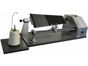 Yarn Evenness Testing Machine measures the yarn appearance on boards.